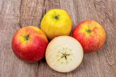 Ripe apples on a wooden background - stock photo