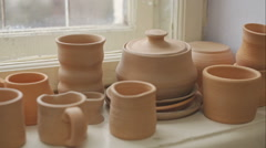 Pottery, mugs and other products on the sills of old pottery. RAW video record - stock footage