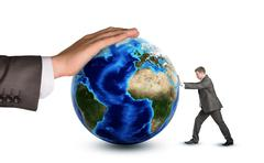 Businessman pushing earth globe - stock photo