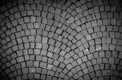 Stock Photo of Dark paving stone roadway