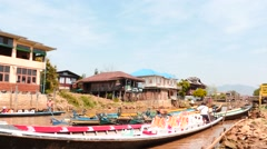 Fishers boats at piers near Inle lake in Myanmar time lapse Stock Footage