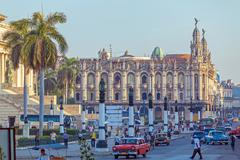 HAVANA, CUBA - APRIL 2, 2012: Heavy traffic with taxi bikes and vintage cars - stock photo