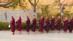 Stock Video Footage of Early morning young Monks ceremony in Myanmar