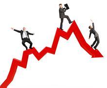 Businessmen falling from arrow - stock photo