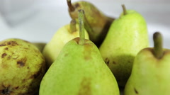 Video overview of many pears. Fruit Still Life in a white box. - stock footage