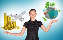 Stock Photo of Businesswoman holding coins and earth globe