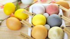 Easter eggs painted with natural egg dye from fruits and vegetables. Stock Footage