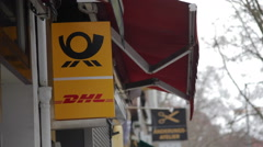 Deutsche post and DHL logo shop sign, post office, Berlin, Germany Stock Footage