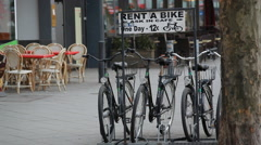 Rent a bike, ask in cafe sign, bicycles for rent, Berlin, Germany - stock footage