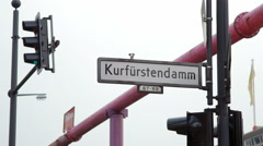 The infamous Kurfürstendamm Ku'damm street corner sign, Berlin, Germany - stock footage