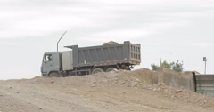 Truck Unloads Rubble In Stone Crushing Machine (4K) Stock Footage