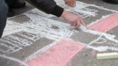 Children draw on the asphalt Stock Footage