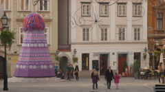 Mother and daughters walking down the Gornji street in Ljubljana - stock footage
