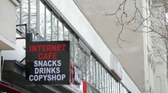 Internet cafe snacks drinks copyshop sign, Berlin, Germany Stock Footage