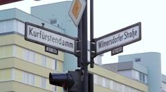 Corner of Kurfürstendamm Ku'damm and Wilmersdorfer street sign, Berlin Stock Footage
