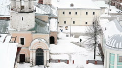 Janitor cleans snow in the yard of the monastery Stock Footage