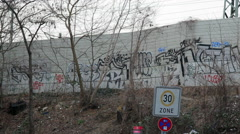 30 speed limit zone sign, graffiti street art on wall, Berlin, Germany Stock Footage