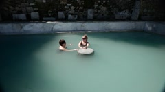 Couple Women Take Baths Near Antique Ruins. 4K. Stock Footage