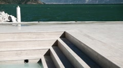 Marble Steps Into the Pool With Deep Shadows. 4K, Tilt Stock Footage