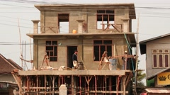 Builders finishing work - Myanmar house building Stock Footage