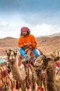 Bedouin on camel, Petra, Jordan Kuvituskuvat