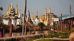 Pagodas at Inle lake of Myanmar - slow motion in sunny day Stock Footage