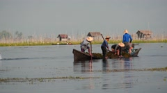 Fishers of Inle lake of Myanmar - view from rocking boat Stock Footage