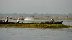 Fishers on boats in waters at Inle lake  in Myanmar - view from rocking ship Stock Footage