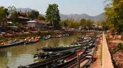 Jetty in Nyaungshwe at Inle lake with people and boat motion time lapse 2 Stock Footage