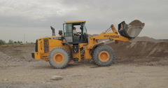 Loader Is Unloading Scoop With Gravel (4K) Stock Footage