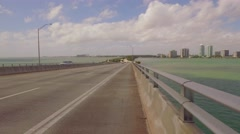 Bicycle riding on the Rickenbacker Causeway Stock Footage