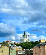 Golden Domes of Saint Andrew's Church in Kiev against the dramatic sky. - stock photo