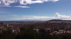 Aerial Barcelona cityscape from three cross hill. pan shot at sunny daytime Stock Footage