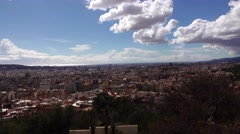 Aerial pan shot of Barcelona from three cross hill at Park Guell. Sunny day Stock Footage