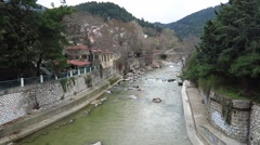 Kosynthos river water running by the city of Xanthi, Greece on a cloudy day Stock Footage