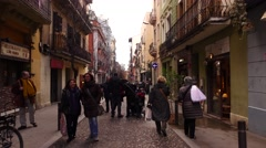 Citizens at small Barcelona alley, POV walk forward, family with baby carriage Stock Footage