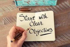 Handwritten text Start With Clear Objectives Stock Photos