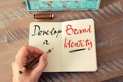 Handwritten text Develop A Brand Identity - stock photo