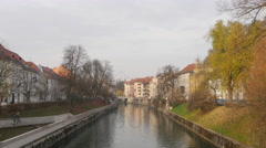 Ljubljanica River on a beautiful autumn day in Ljubljana Stock Footage