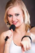 Woman singing rock song microphone Stock Photos