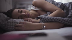 Portrait of a sleeping woman, young handsome female in her 20s is resting in a - stock footage