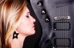 Sexy profil face girl and Guitar Woman - stock photo