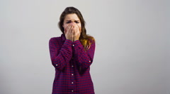 Young girl upset emotion in front of white wall Stock Footage
