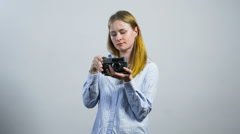 Smiling young girl taking pictures with an old vintage camera Stock Footage