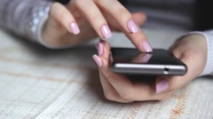 Elegant Beautiful Woman Hands Texting on Smartphone in the Cafe v2 - stock footage