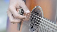 Playing guitar with a finger - stock footage