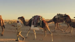 Caravan of nomads in tunisian sahara desert Stock Footage