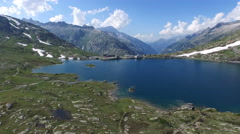 Aerial Footage over the Grimsel lake with pass heigt in Switzerland, 4K, UHD Stock Footage