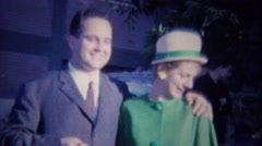 Stock Video Footage of 1963: Newlyweds woman overjoyed emotion crying green dress suit.
