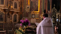 The priest prays in church Stock Footage